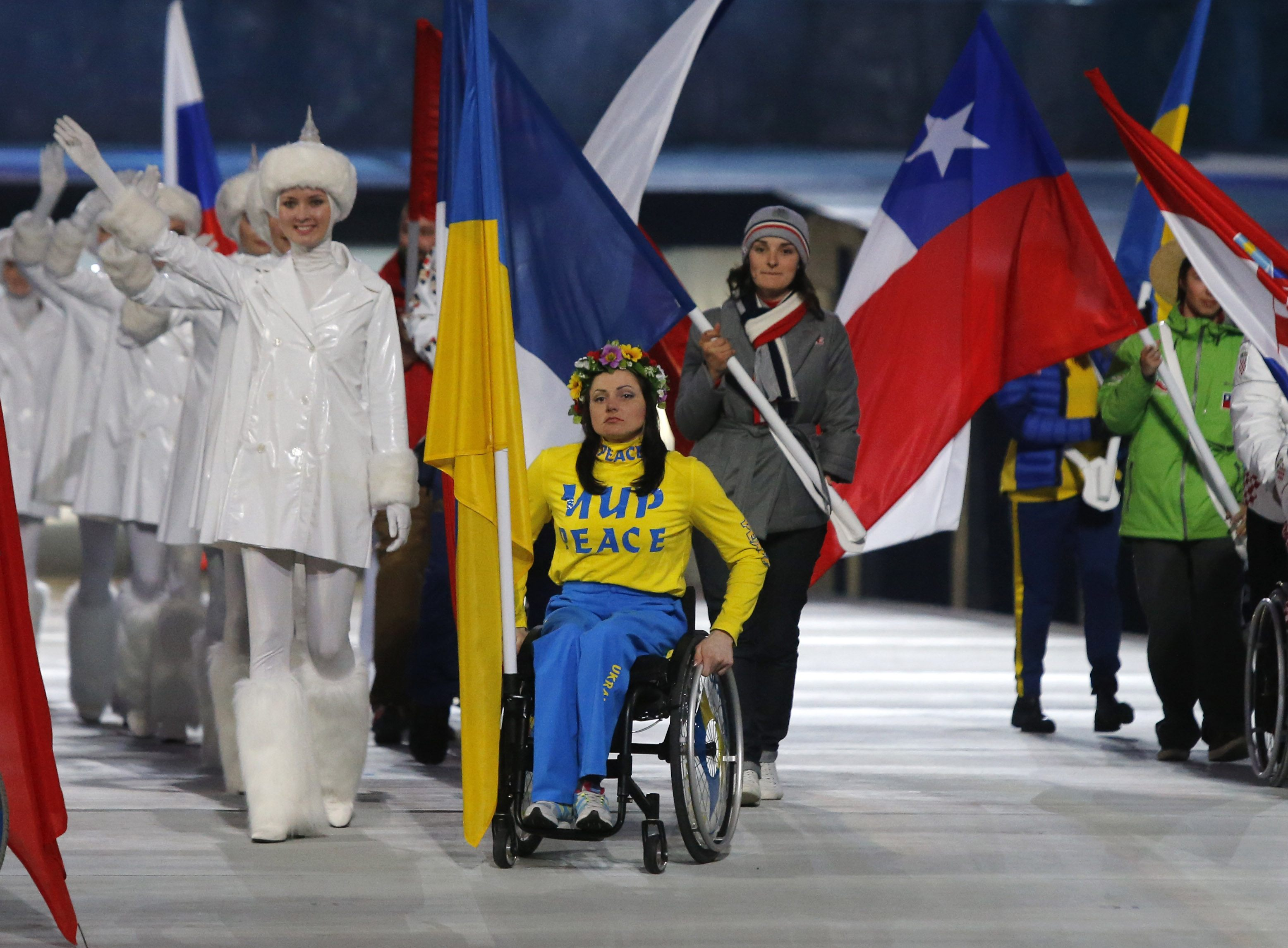 Ukraine's flag-bearer Pavlenko arrives at the stadium during the closing ceremony of the 2014 Paralympic Winter Games in Sochi